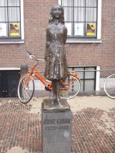 bronze statue of Anne Frank near her house
