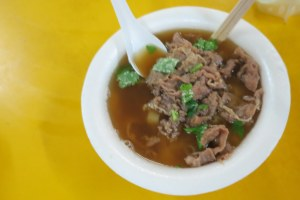 Beef noodle soup with cilantro