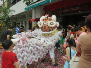 The shop owner hired these dancers (and musicians out of frame) to do the lion dance outside the shop. The kids dig it.