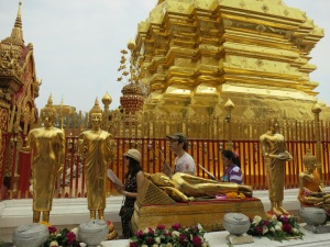 Walking around the stupa (or chedi) and chanting prayers