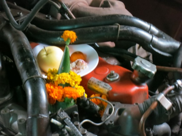 Offerings on the engine for a safe journey (blame the blurriness on rumble of  the engine)