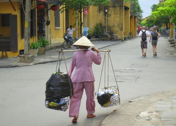 Carrying different loads--the locals and the tourists