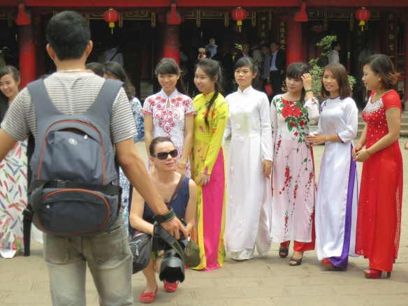 And then it got weird, with tourists hopping in to pose with the students, getting in the way of the students' own photos.