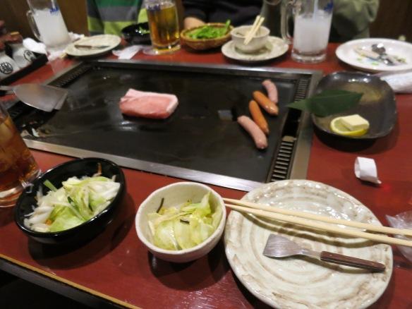 Making meats to accompany the okonomiyaki