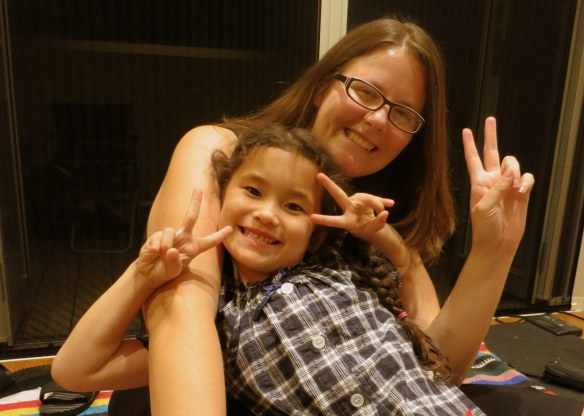 Carmen's only seven, but she already knows to flash peace signs in every photo