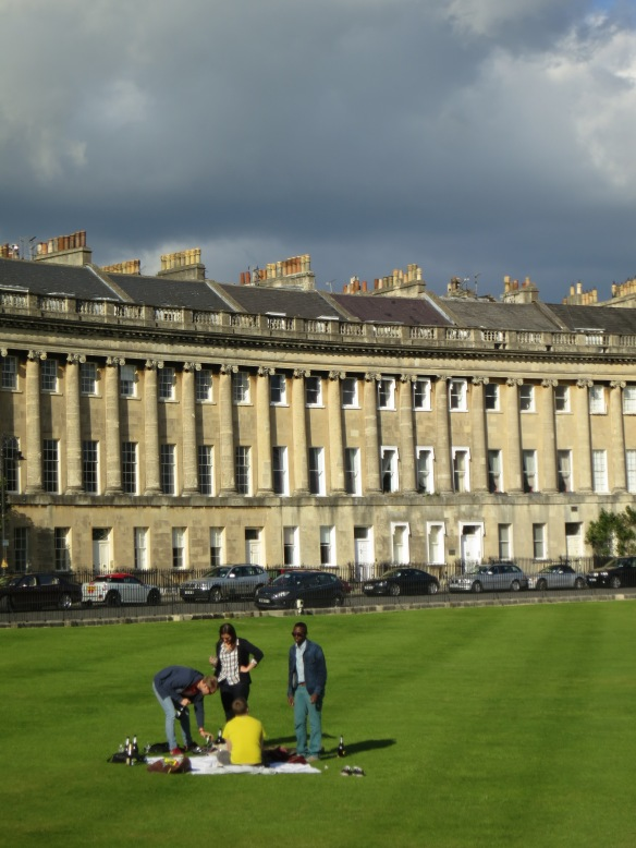 In what had to be a parody of rich kids, these teenagers stumbled out of one of the Royal Crescent apartments, jumped the fence to their private lawn, and started glugging champagne in the afternoon sun.