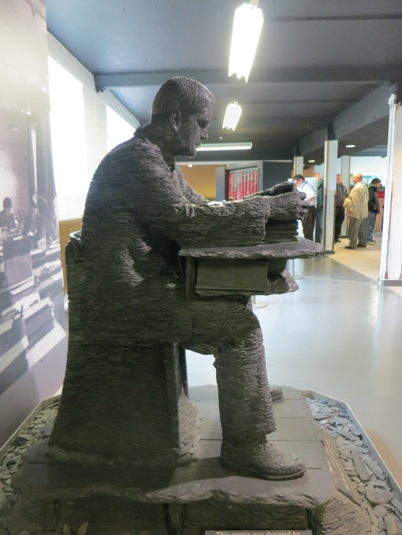 Stephen Kettle's slate statue of Alan Turing at work