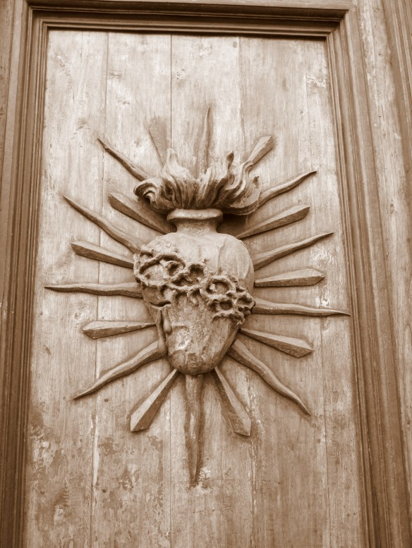 Sacred Heart on a church door