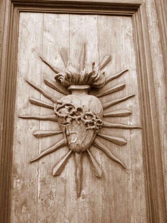Sacred Heart on a church door