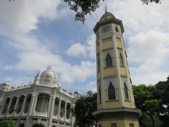 Clock tower, and across the road, an attractive government building