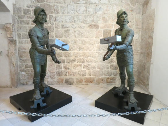 """The """"zelenci""""--the bronze statues that hit the bell in Orlando's Tower. I believe these are the originals and replicas currently keep time in the tower."""