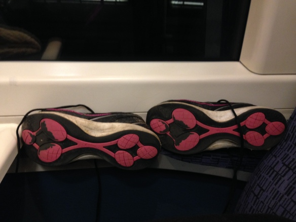 Drying my shoes out on the heater of the train