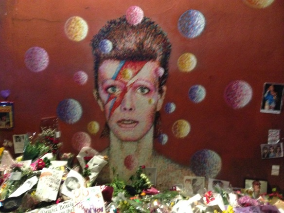 The shrine at the Bowie mural in Brixton