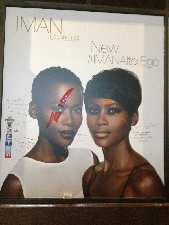 Iman's makeup line was in the shop window next to the mural--obviously visitors decided to add the ad to the celebration